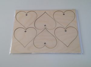 6 heart shapes laser cut from birch plywood