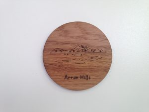 Oak coaster laser cut in solid oak etched with outline of Arran Hills