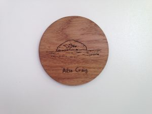 Oak coaster laser cut in solid oak etched with outline of Ailsa Craig