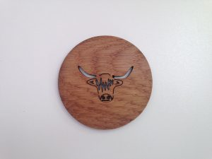 Solid Oak coaster with laser cut outline of highland cow head