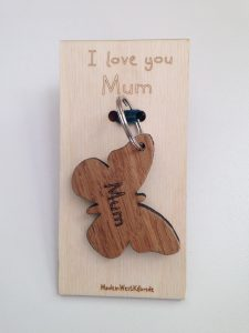 Key ring laser cut from solid oak in butterfly shape and engraved with 'Mum' and birch ply plaque with I Love you Mum