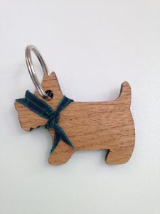 Oak key ring laser cut in shape of dog with tartan neckerchief