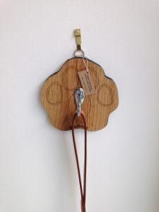 Wooden oak dog lead holder in shape of dog's paw