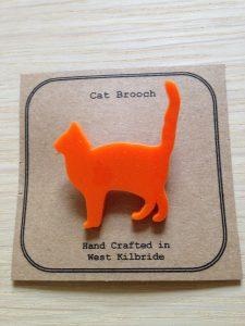 Cat brooch laser cut from orange acrylic