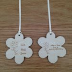 Flower shaped gift tags laser cut from 3mm birch plywood with Get well soon/lots of love for a speedy recovery or your own message