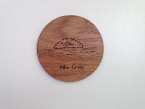 Oak coaster laser cut in solid oak etched with outline of Ailsa Craig